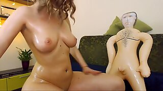 Big tits young babe playing with sex doll on webcam